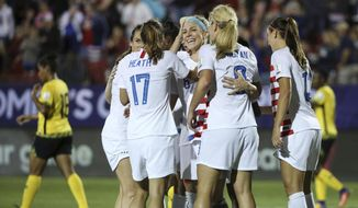 Teammates celebrate after United States midfielder Julie Ertz (facing camera) scored a goal during the first half of a CONCACAF women's World Cup qualifying tournament soccer match in Frisco, Texas, Sunday, Oct. 14, 2018. (AP Photo/Andy Jacobsohn)