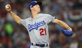 In this Oct. 7, 2018 file photo Los Angeles Dodgers starting pitcher Walker Buehler (21) delivers during the first inning in Game 3 of MLB baseball's National League Division Series against the Atlanta Braves in Atlanta. Buehler had one bad inning against Atlanta in the NL Division Series. Now the pressure is on the rookie again as the Dodgers return home to host the Brewers in Game 3 of the NL Championship Series, which is tied at 1-all. (AP Photo/John Bazemore,File)