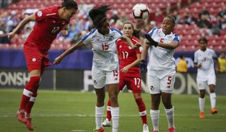 Panama defender Rebeca Espinosa (15) and defender Yomira Pinzon (5) attempt to defend against Canada forward Christine Sinclair (12) as Sinclair scores a goal during the second half of a soccer match at the CONCACAF women's World Cup qualifying tournament in Frisco, Texas, Sunday, Oct. 14, 2018. (AP Photo/Andy Jacobsohn)