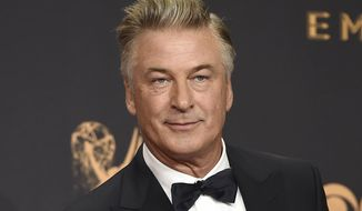 "In this Sept. 17, 2017, photo, Alec Baldwin poses in the press room with the award for outstanding supporting actor in a comedy series for ""Saturday Night Live"" at the 69th Primetime Emmy Awards in Los Angeles. (Photo by Jordan Strauss/Invision/AP) **FILE**"