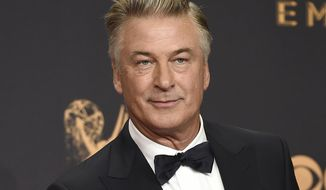 "In this Sept. 17, 2017, photo, Alec Baldwin poses in the press room with the award for outstanding supporting actor in a comedy series for ""Saturday Night Live"" at the 69th Primetime Emmy Awards in Los Angeles. Baldwin says voters should see the Nov. 6 midterm elections as an opportunity to peacefully ""overthrow the government of Donald Trump."" Baldwin spoke Sunday night, Oct. 14, 2018, at a fundraising dinner for the New Hampshire Democratic Party a night after returning to ""Saturday Night Live"" to portray the president. (Photo by Jordan Strauss/Invision/AP) **FILE**"