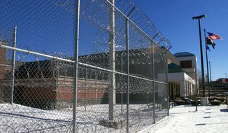 FILE - This Jan. 14, 2000, file photo shows the exterior of the Garner Correctional Institution in Newtown, Conn. Guards and inmates at the institution are on the same side of a legal fight against the state over radon. A ruling by federal judge last month will allow 13 inmates to move forward with a lawsuit that alleges the state confined them in inhumane conditions because of high levels of the radioactive gas. A group of 16 former guards and staff member sued in August. (Tom Kabelka/Republican-American via AP, File)