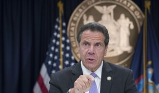 FILE - In a Friday, Sept. 14, 2018 file photo, New York Gov. Andrew Cuomo speaks to reporters during a news conference, in New York. Gov. Andrew Cuomo questioned Sunday, Oct. 14, 2018 why state Republicans would have invited the founder of a far-right group to speak in Manhattan, and he blamed them and President Donald Trump for violent clashes that took place after the speech.  (AP Photo/Mary Altaffer, File)