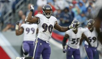 Baltimore Ravens linebacker Za'Darius Smith (90) celebrates after sacking Tennessee Titans quarterback Marcus Mariota and forcing a fumble in the first half of an NFL football game Sunday, Oct. 14, 2018, in Nashville, Tenn. The Titans recovered the ball on the play. (AP Photo/Wade Payne)