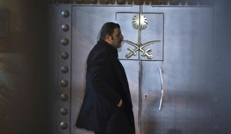A security personnel stands at the entrance of Saudi Arabia's consulate in Istanbul, Saturday, Oct. 13, 2018. Turkish officials have an audio recording of the alleged killing of journalist Jamal Khashoggi from the Apple Watch he wore when he walked into the Saudi Consulate in Istanbul over a week ago, a pro-government Turkish newspaper reported Saturday. (AP Photo/Petros Giannakouris)