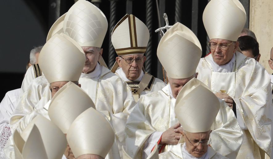 Pope Francis, center, arrives for a canonization ceremony in St. Peter's Square at the Vatican, Sunday, Oct. 14, 2018. Pope Francis canonizes two of the most important and contested figures of the 20th-century Catholic Church, declaring Pope Paul VI and the martyred Salvadoran Archbishop Oscar Romero as models of saintliness for the faithful today. (AP Photo/Andrew Medichini)