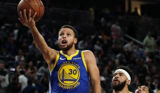 Golden State Warriors guard Stephen Curry will receive his third NBA title ring in four seasons when the league kicks off its season on Tuesday night. (ASSOCIATED PRESS)