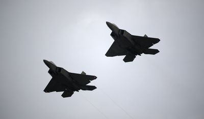Two U.S. Air Force F-22 fighter jets perform a flyover during the playing of the national anthem before a NASCAR Cup Series auto race at Daytona International Speedway, Saturday, July 7, 2018, in Daytona Beach, Fla. (AP Photo/Phelan M. Ebenhack) ** FILE **