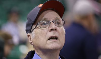 In this Oct. 12, 2015, file photo, Portland Trail Blazers owner Paul Allen looks on before the start of the first quarter of an NBA preseason basketball game against the Utah Jazz in Salt Lake City. Allen, billionaire owner of the Trail Blazers and the Seattle Seahawks and Microsoft co-founder, says cancer he was treated for in 2009 has returned. Allen made the announcement Monday, Oct. 1, 2018 on Twitter, saying he recently learned of the non-Hodgkin's lymphoma and that his team of doctors has started treatment. (AP Photo/Rick Bowmer, File)