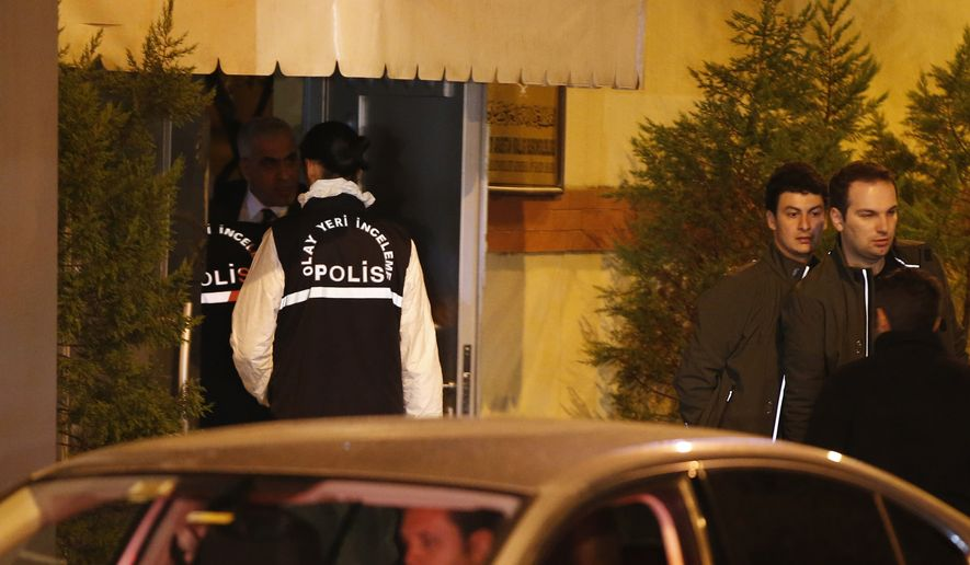 """Turkish police officers enter the Saudi Arabia's Consulate in Istanbul, Monday, Oct. 15, 2018. Turkey and Saudi Arabia are conducting a joint """"inspection"""" on Monday of the consulate, where Saudi journalist Jamal Khashoggi went missing nearly two weeks ago, Turkish authorities said.v(AP Photo/Emrah Gurel)"""