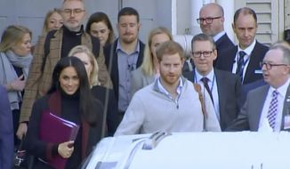 In this image made from video, Britain's Prince Harry, center right, and his wife Meghan Markle, left, Duke and Duchess of Sussex, approach a car at an airport in Sydney, Monday, Oct. 15, 2018. Prince Harry and his wife Meghan arrived in Sydney on Monday, a day before they officially start a 16-day tour of Australia and the South Pacific. Kensington Palace says Prince Harry and Meghan the Duchess of Sussex are expecting a child in the spring. (Australian Pool via AP)