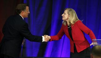 Virginia Congressman Dave Brat, R-Va., left, shakes hands with Democratic challenger Abigail Spanberger, right, after a debate at Germanna Community College in Culpeper, Va., Monday, Oct. 15, 2018. (AP Photo/Steve Helber) ** FILE **