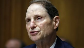 In this June 28, 2018, file photo, Sen. Ron Wyden, D-Ore., ranking member of the Senate Finance Committee, speaks during a hearing on the nomination of Charles Rettig for Internal Revenue Service Commissioner on Capitol Hill in Washington. Low-income people in states that haven't expanded Medicaid are much more likely to forgo needed medical care than the poor in other states, according to a government report due out Monday, Oct. 15, amid election debates from Georgia to Utah over coverage for the needy. (AP Photo/Jacquelyn Martin, File)
