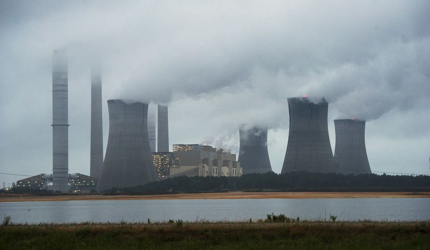 This June 1, 2014, file photo show the coal-fired Plant Scherer in operation in Juliette, Ga. (AP Photo/John Amis, File)