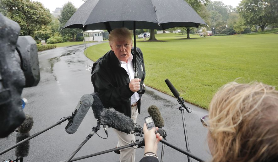 President Donald Trump stops to answer questions from members of the media before walking across the South Lawn of the White House in Washington, Monday, Oct. 15, 2018, to board Marine One helicopter for a short trip to Andrews Air Force Base, Md., en route to Florida to tour areas the devastation left behind from Hurricane Michael last week. (AP Photo/Pablo Martinez Monsivais)