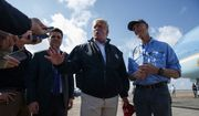 Gov. Rick Scott, R-Fla., right, looks on as President Donald Trump talks with reporters after arriving at Eglin Air Force Base to visit areas affected by Hurricane Michael, Monday, Oct. 15, 2018, in Eglin Air Force Base, Fla. (AP Photo/Evan Vucci)