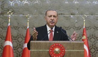 Turkey's President Recep Tayyip Erdogan addresses provincial muftis at the presidential palace in Ankara, Turkey, Monday, Oct. 15, 2018. (Presidential Press Service via AP, Pool)