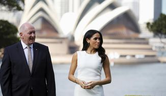 Britain's Meghan, Duchess of Sussex looks on next to Australia's Governor General Peter Cosgrove at Admiralty House in Sydney, Australia, Tuesday, Oct. 16, 2018. Prince Harry and his wife Meghan are on a 16-day tour of Australia and the South Pacific.(Phil Noble/Pool via AP)