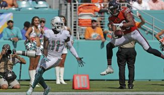 Chicago Bears cornerback Kyle Fuller (23) intercepts a pass intended for Miami Dolphins wide receiver DeVante Parker (11), during the first half of an NFL football game, Sunday, Oct. 14, 2018, in Miami Gardens, Fla. (John McCall/South Florida Sun-Sentinel via AP)