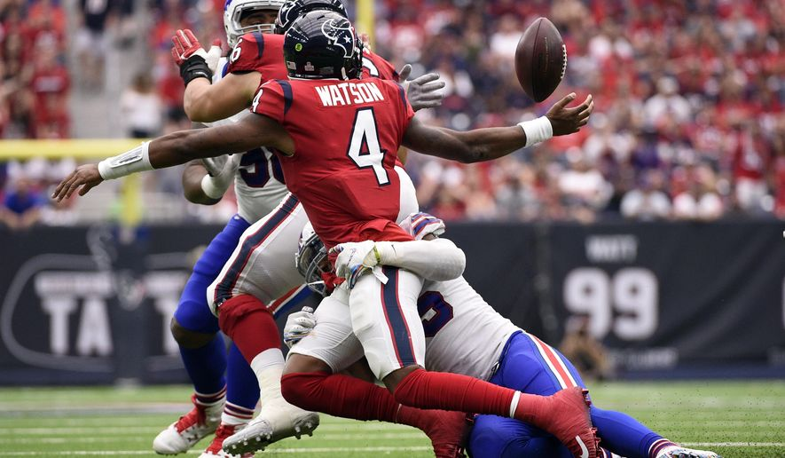 Houston Texans quarterback Deshaun Watson (4) fumbles as he is hit by Buffalo Bills defensive end Eddie Yarbrough (54) during the second half of an NFL football game, Sunday, Oct. 14, 2018, in Houston. Buffalo Bills recovered the ball. (AP Photo/Eric Christian Smith)