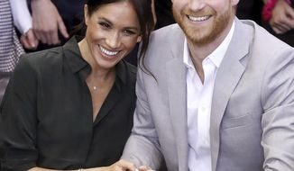 FILE - In this file photo dated Wednesday Oct. 3, 2018, Meghan, Duchess of Sussex and Britain's Prince Harry, make an official visit to the Joff Youth Centre in Peacehaven, Britain.  Kensington Palace announced Monday Oct. 15, 2018, that Prince Harry and his wife the Duchess of Sussex are expecting a child in spring 2019.  (Chris Jackson/pool via AP)