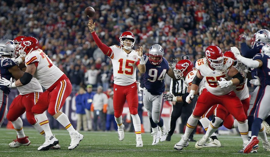 Kansas City Chiefs quarterback Patrick Mahomes (15) throws a touchdown pass to wide receiver Tyreek Hill (10) during the second half of an NFL football game against the New England Patriots, Sunday, Oct. 14, 2018, in Foxborough, Mass. (AP Photo/Michael Dwyer)