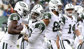 New York Jets tight end Chris Herndon (89) is congratulated by wide receiver Jermaine Kearse (10) after catching a touchdown pass from quarterback Sam Darnold (14) during the second half of an NFL football game, Sunday, Oct. 14, 2018, in East Rutherford, N.J. (AP Photo/Bill Kostroun)
