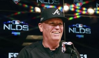 CORRECTS DAY AND DATE - Atlanta Braves manager Brian Snitker speaks to reporters before Game 2 of the baseball team's National League Division Series against the Los Angeles Dodgers on Friday, Oct. 5, 2018, in Los Angeles. (Curtis Compton/Atlanta Journal Constitution via AP)