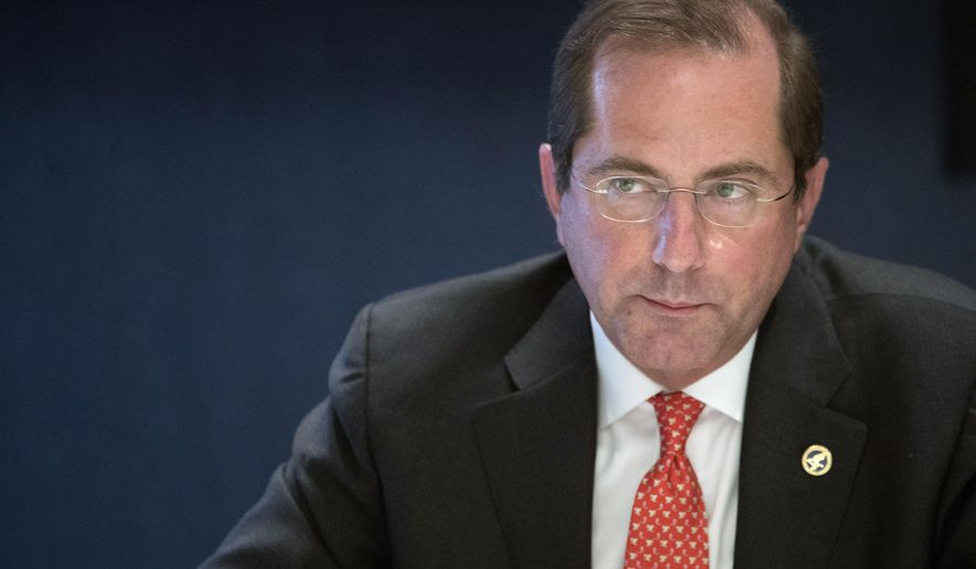 """FILE- In this Sept. 12, 2018, file photo Health & Human Services Secretary Alex Azar speaks during an interview with The Associated Press in New York.  In a move announced Monday, Oct. 14, by the industry's largest trade group dozens of drugmakers will start disclosing the prices for U.S. prescription drugs advertised on TV. Azar responded that the industry's announcement is a """"small step in the right direction"""" but the government's plan """"will go further."""" (AP Photo/Mary Altaffer, File)"""