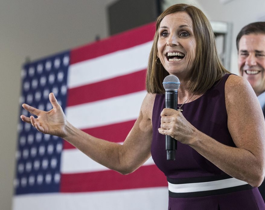 In this Oct. 12, 2018, file photo, U.S. Rep. Martha McSally, R-Ariz., addresses her constituents during a Get Out the Vote Rally in Gilbert, Ariz. (AP Photo/Darryl Webb, file)