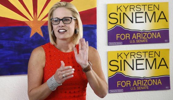 Rep. Kyrsten Sinema, D-Ariz., talks to campaign volunteers at a Democratic campaign office on primary election day in Phoenix.  (AP Photo/Ross D. Franklin, file)