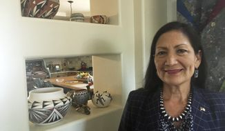 File - In this June 6, 2018, file photo, Deb Haaland, a Democratic candidate for Congress for central New Mexico's open seat and a tribal member of the Laguna Pueblo, speaks at her Albuquerque home. Three candidates for a key congressional district that encompasses New Mexico's most populated area are scheduled Monday, Oct. 15, 2018, to debate on their stances on the economy and other issues. (AP Photo/Russell Contreras, File)