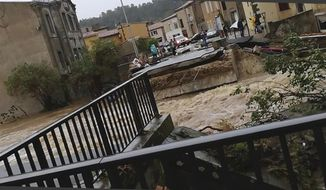 This photo provided by Stephane Jourdain, after a torrent of water ripped out the bridge in Villegailhenc, southern France, Monday Oct. 15, 2018. Flash floods have left several people dead in southwest France, with roads swept away and streams become raging torrents as the equivalent of several months of rain fell overnight, authorities said Monday. (AP Photo/Stephane Jourdain)