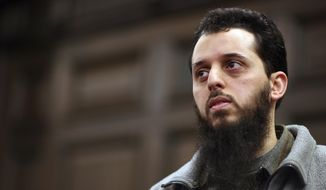 In this Jan. 8, 2007, file picture Moroccan Mounir El Motassadeq waits prior his trial at a court in Hamburg, northern Germany, The Moroccan man has been sentenced to a 15-year prison sentence in Germany for helping three of the suicide pilots in the 9/11 attacks on the U.S. (AP Photo/Fabian Bimmer, Pool)