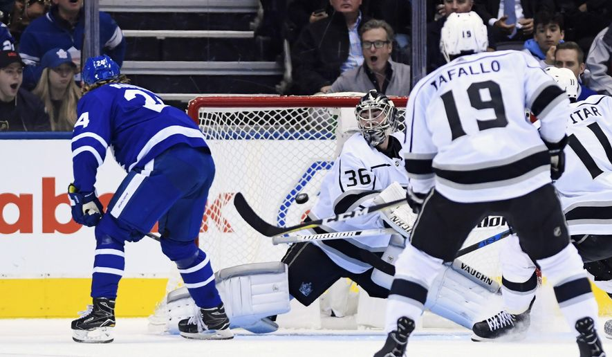 Toronto Maple Leafs right wing Kasperi Kapanen (24) scores on Los Angeles Kings goaltender Jack Campbell (36) during third period NHL hockey action in Toronto on Monday, Oct. 15, 2018. (Nathan Denette/The Canadian Press via AP)
