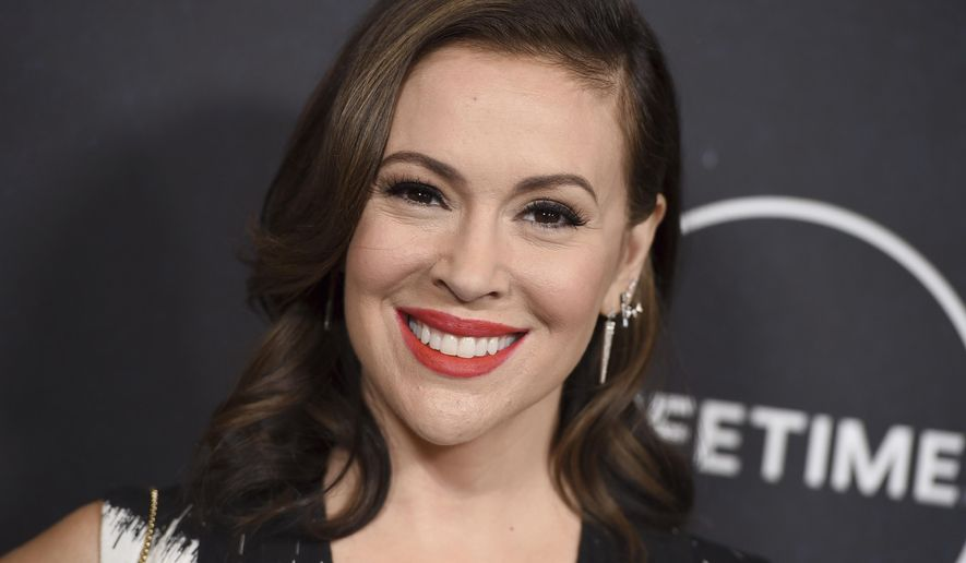 In this Oct. 12, 2018, file photo, Alyssa Milano arrives at Variety's Power of Women event at the Beverly Wilshire hotel in Beverly Hills, Calif. On Oct. 15, 2017, Milano urged the Twittersphere to join her in sharing a personal story of sexual harassment in the wake of rape allegations against Harvey Weinstein. The response was immediate and overwhelming, and touched off a cultural movement that has shed light on the pervasiveness of sexual harassment, assault and violence against women across all industries, building on work started over a decade earlier by activist Tarana Burke. (Photo by Jordan Strauss/Invision/AP, File)