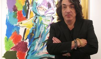 In this Oct. 13, 2018 photo, Paul Stanley, singer and guitarist for the rock group Kiss, poses next to his artwork at a gallery in Atlantic City, N.J. Stanley said he is open to the idea of former Kiss members performing as part of the band's upcoming farewell tour next year. (AP Photo/Wayne Parry)