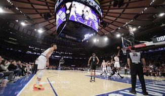 New York Knicks' Frank Ntilikina (11) drives to the basket during the first half of a preseason NBA basketball game against the Brooklyn Nets on Friday, Oct. 12, 2018, in New York. (AP Photo/Frank Franklin II)