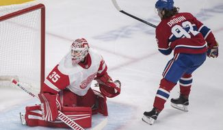 Montreal Canadiens' Jonathan Drouin scores on a penalty shot against Detroit Red Wings goaltender Jimmy Howard during first period NHL hockey action in Montreal, Monday, Oct. 15, 2018. (Graham Hughes/The Canadian Press via AP)