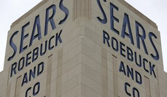 A sign for a Sears department store is displayed in Hackensack, N.J., Monday, Oct. 15, 2018. Sears filed for Chapter 11 bankruptcy protection Monday, buckling under its massive debt load and staggering losses. (AP Photo/Seth Wenig)