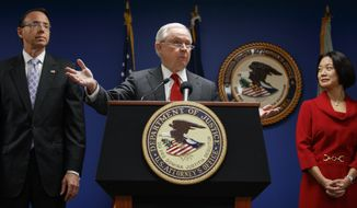 Attorney General Jeff Sessions, joined by Deputy Attorney General Rod Rosenstein, left, and Jessie Liu, U.S. Attorney for the District of Columbia, right, speaks during a news conference at the U.S. Attorney's Office for the District of Columbia in Washington, Monday, Oct. 15, 2018, to announce on efforts to reduce transnational crime. (AP Photo/Carolyn Kaster)