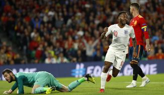 England's Raheem Sterling, left, celebrates after scoring his side's third goal during the UEFA Nations League soccer match between Spain and England at Benito Villamarin stadium, in Seville, Spain, Monday, Oct. 15, 2018. (AP Photo/Miguel Morenatti)