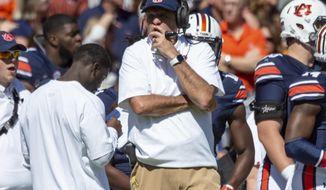 Auburn head coach Gus Malzahn looks on during the first half of an NCAA college football game against Tennessee, Saturday, Oct. 13, 2018, in Auburn, Ala. (AP Photo/Vasha Hunt)