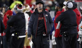 San Francisco 49ers head coach Kyle Shanahan watches the scoreboard during the first half of an NFL football game against the Green Bay Packers Monday, Oct. 15, 2018, in Green Bay, Wis. (AP Photo/Matt Ludtke)