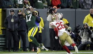 Green Bay Packers wide receiver Davante Adams (17) makes a catch against San Francisco 49ers cornerback Greg Mabin (26) during the second half of an NFL football game Monday, Oct. 15, 2018, in Green Bay, Wis. The Packers won 33-30. (AP Photo/Mike Roemer)