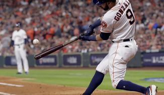 Houston Astros' Marwin Gonzalez hits a RBI-single against the Boston Red Sox during the first inning in Game 3 of a baseball American League Championship Series on Tuesday, Oct. 16, 2018, in Houston. (AP Photo/Frank Franklin II) ** FILE **