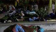 Honduran migrants sleep at an improvised shelter in Esquipulas, Guatemala, Monday, Oct. 15, 2018. The group, estimated at 1,600 to 2,000 people hoping to reach the United States, bedded down for the night in this town after Guatemala's authorities blinked first in attempts to halt their advance. (AP Photo/Moises Castillo)