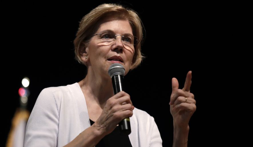 U.S. Sen. Elizabeth Warren, D-Mass., during a town hall style gathering in Woburn, Wednesday, Aug. 8, 2018. (AP Photo/Charles Krupa)