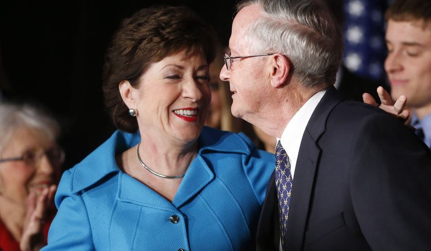 Incumbent U.S. Sen. Susan Collins, R-Maine, celebrates with husband Thomas Daffron, right, her re-election victory over Democrat Shenna Bellows Tuesday, Nov. 4, 2014, in Portland, Maine. (AP Photo/Bill Sikes)