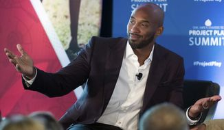 Former NBA basketball all-star Kobe Bryant gestures as he moderates a panel about youth sports during the Aspen Institute's Project Play Summit, Tuesday, Oct. 16, 2018 in Washington. (AP Photo/Alex Brandon)